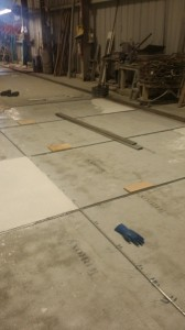 Here is the installation of epoxy terrazzo in progress.