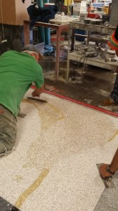 "When the grinding is complete it produces small pin holes in the terrazzo which requires the Terrazzo Mechanic to fill the holes with epoxy.  This procedure is called ""grouting."""